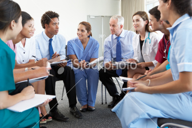 stock-photo-20115652-medical-staff-seated-in-circle-at-case-meeting